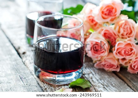Valentine's Day Still Life with Glasses of Red Wine and Bouquet of Pink Roses on Wooden Table, vintage style - stock photo