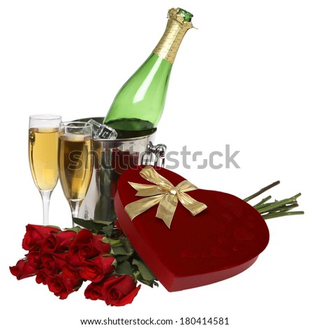 Valentine's day still life with heart shaped chocolate box, champagne bottle, glasses, and doze roses  - stock photo