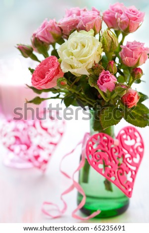 Valentine's Day table decoration of flowers and hearts - stock photo