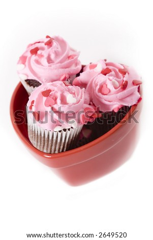 Valentine's Day themed cupcakes with heart sprinkles - stock photo