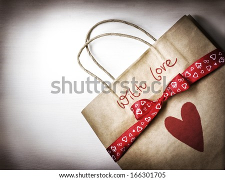 Valentine's gift bag with red ribbon and heart/ Valentines day background - stock photo