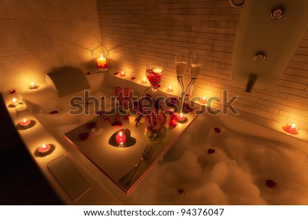 Valentine's gift: romantic dinner in exclusive spa with candles and champagne - stock photo