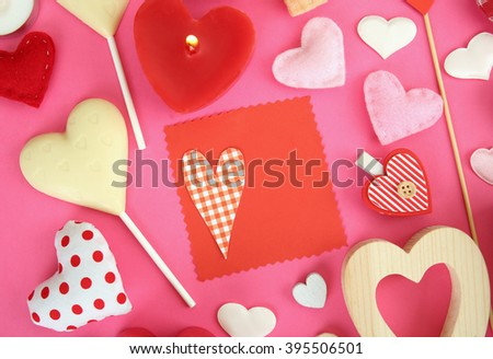 Valentine's gift with sweets and decor on pink background, top view