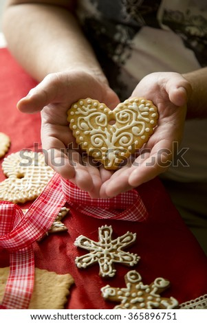 Valentine's heart cake presented in children's hands - stock photo