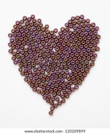 Valentine's heart made of glass beads, on white background - stock photo