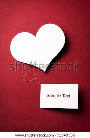 Valentines paper heart blank business card stock photo royalty free valentines paper heart with a blank business card on a red background valentines day colourmoves