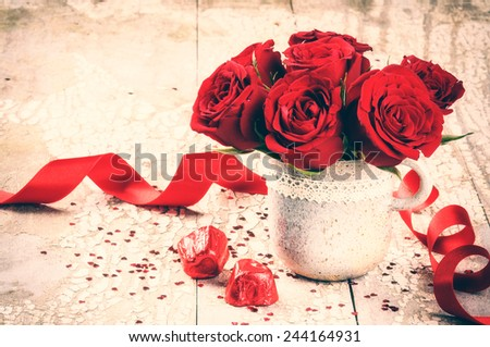 Valentine's setting with bouquet of red roses and chocolate  - stock photo