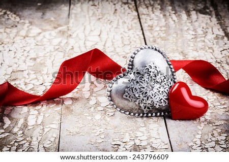 Valentine's setting with decorative hearts and red ribbon  - stock photo