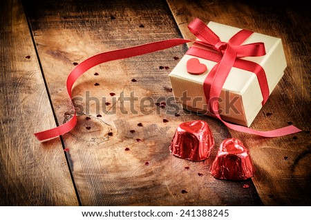Valentine's setting with gift box and chocolate - stock photo