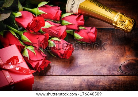 Valentine's setting with red roses and present  - stock photo