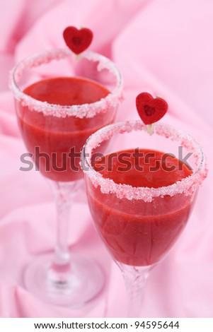 Valentine's strawberry drink in wine glasses. Shallow dof - stock photo