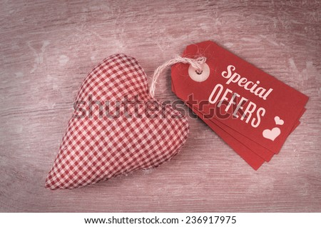 "Valentine's tags with caption ""Special offers"" and cotton stuffed heart on wood - stock photo"