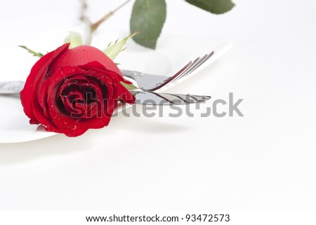 Valentine Series, Red rose and cutlery on white plate - stock photo