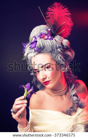 Valentine. Victorian lady. Young woman with flower. - stock photo