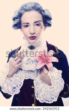 Valentine.  Young woman in gallant cavalier image and with flower