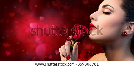 Valentines Beauty - Sensual Model Woman Touching Red Rose Flower  - stock photo
