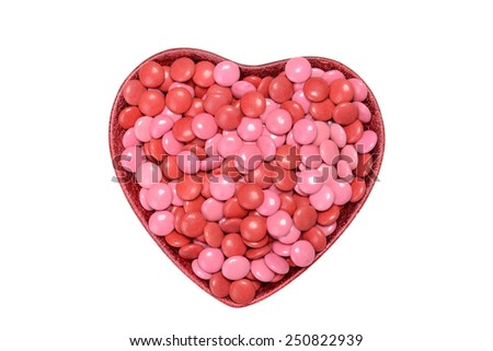 valentines candy coated chocolate in heart bowl - stock photo