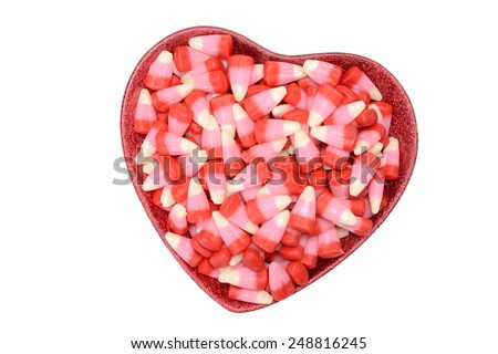 valentines candy corn in heart bowl - stock photo