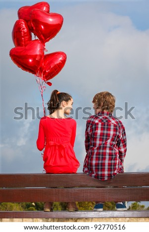 valentines couple with heart balloons - stock photo