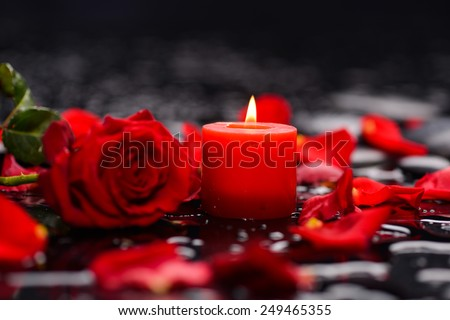 Valentines Day background-red rose with red candle  - stock photo