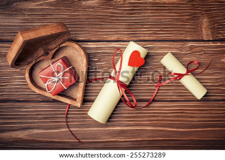 Valentines day background with gift boxes and  rolled papers - stock photo
