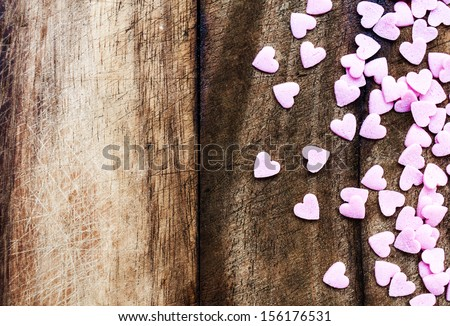Valentines Day background with hearts. Sugar Hearts on wooden vintage textured background or table.  - stock photo