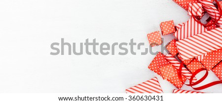 Valentines day background with vintage red dotted and striped gift boxes on the white wooden table. Retro still life
