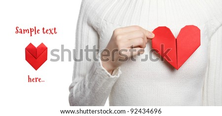 Valentines day banner with girl holding origami heart - stock photo
