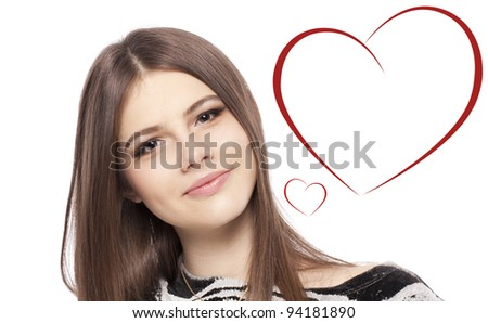 Valentines Day. Beautiful girl teenager with Valentines Day heart sign with copy space glossy brown hair closeup on white background isolated in studio - stock photo