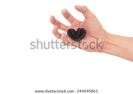 Valentines Day Black Heart paper on Hand with White Isolated Background.