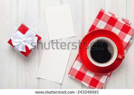 Valentines day blank photo frames, coffee cup and gift box over white wooden table - stock photo