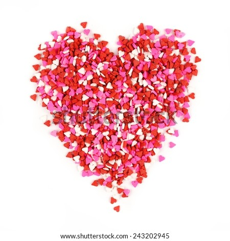 Valentines Day candy heart made of red, white and pink sprinkles - stock photo