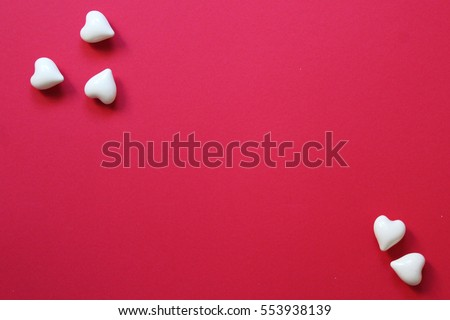 Valentines day composition. Hearts on red background. Top view. Flat lay. Copy space