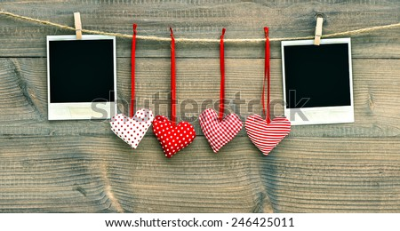 Valentines Day decoration. Red hearts and vintage photo frame - stock photo