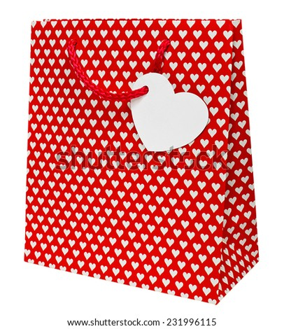 Valentines day gift bag decorated with heart shapes the perfect wrapping for that special present for your loved one on this national holiday. - stock photo