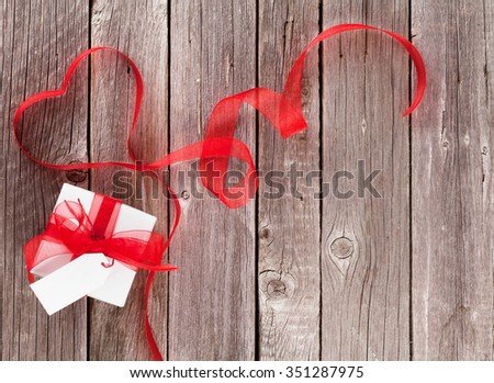 Valentines day gift box and heart shaped ribbon. Top view with copy space - stock photo