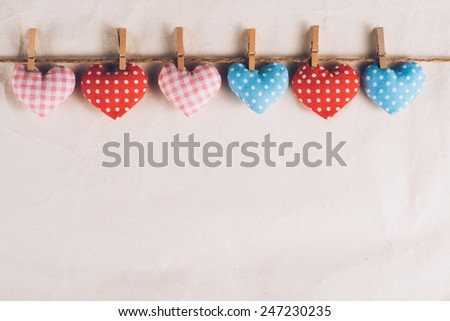 Valentines Day. Heart hanging on rope. Vintage style. Love concept on paper - stock photo