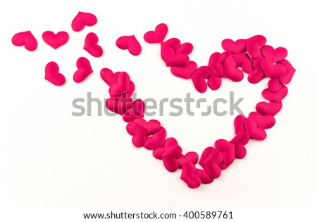 Valentines Day Heart Made of Red little cloth material hearts Isolated on White Background. Big Red Love Heart / seamless close up gift card / wedding