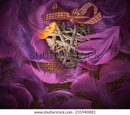 Valentines Day. Heart made of vine in pink feathers . Love concept. Retro - stock photo