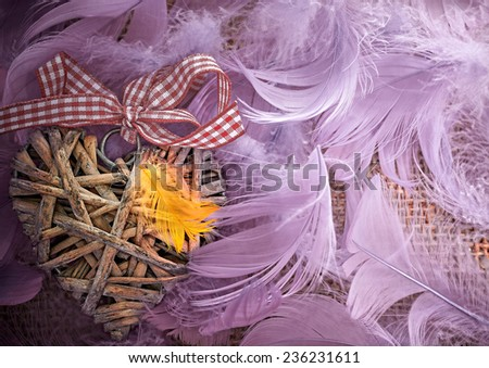 Valentines Day. Heart made of vine in pink feathers. Love. Retro styled, vintage - stock photo