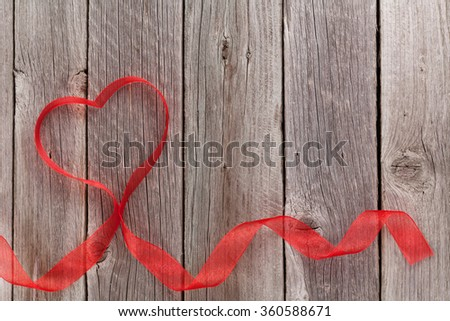 Valentines day heart shaped ribbon on wooden table. Top view with copy space - stock photo