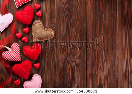 Valentines day hearts and candies over wooden background. Top view with copy space - stock photo