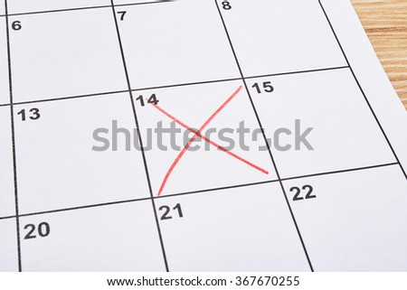 Valentines day in agenda with red cross - stock photo