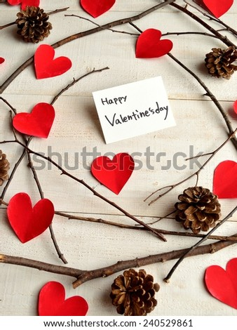 Valentines day message card on red heart paper cut out background.