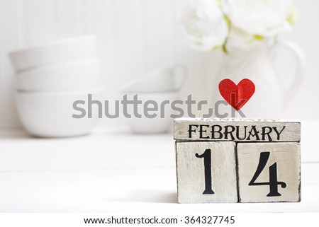 Valentines day theme with wooden block calendar - stock photo
