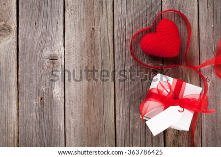 Valentines day toy heart and gift box on wooden table. Top view with copy space - stock photo