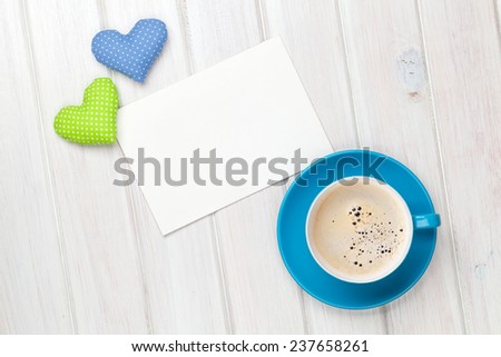 Valentines day toy heart, blank greeting card and coffee cup over wooden table background - stock photo