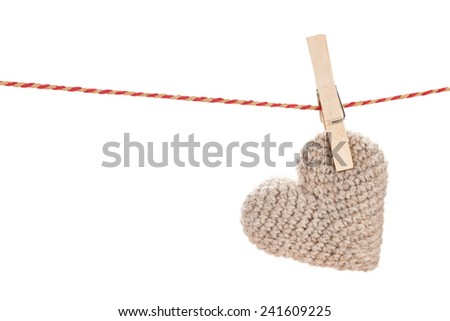 Valentines day toy heart hanging on rope. Isolated on white background - stock photo