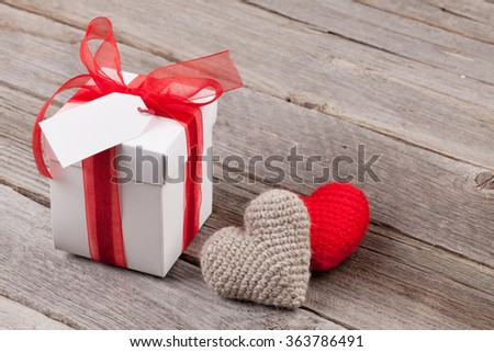 Valentines day toy hearts and gift box on wooden table - stock photo