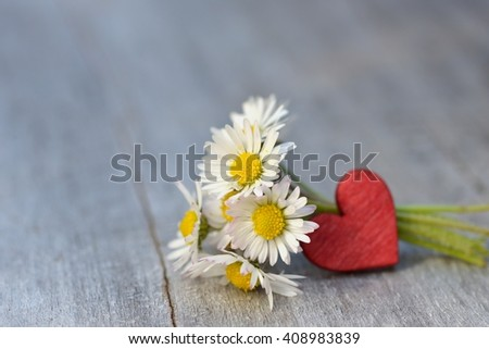 Valentines day. Valentines day - daisy and heart. Heart and daisy flowers on old wood. Background Valentines Day. Valentines day ideas. Valentines day card with daisy and heart. - stock photo
